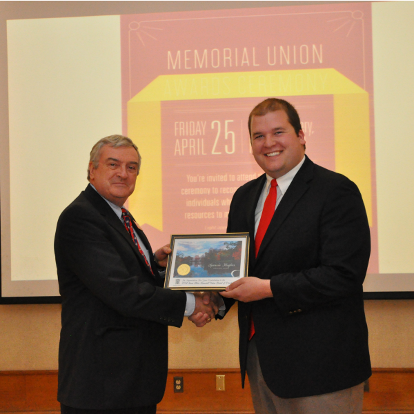 Spencer Hughes receives a Memorial Union Board of Directors Certificate of Service