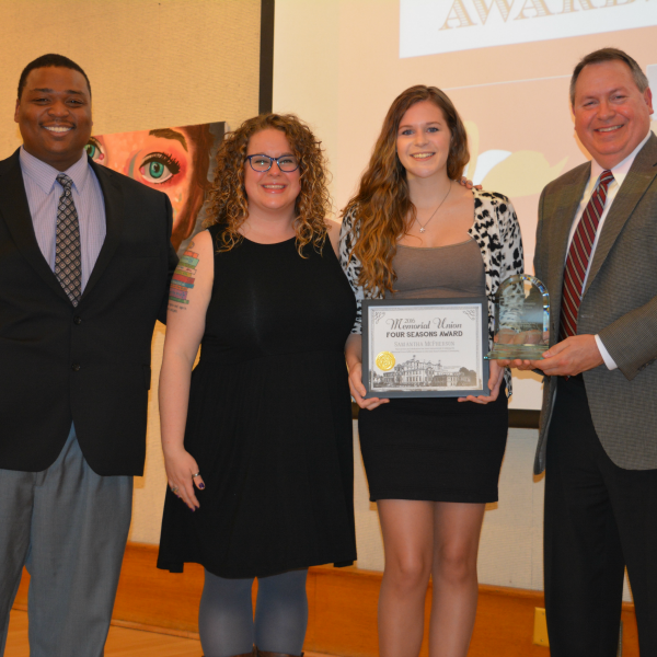 Samantha McPherson (center right) receives the Four Seasons Award