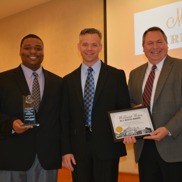 Jathan Chicoine (center) receives the M.J. Riggs award