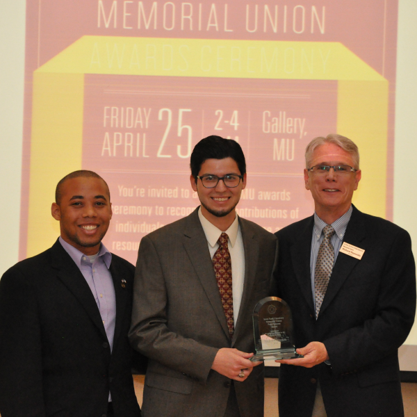 Nick Morton (Middle) is awarded the Four Seasons award