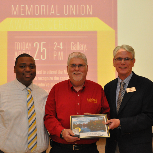Rod Simpson receives a Memorial Union Service Pin for his 35 years of service.